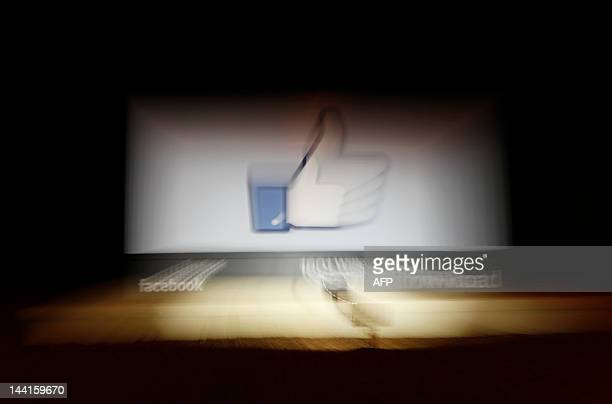 Facebook Like Button logo is seen at the entrance of the Facebook headquarters in Menlo Park on May 10, 2012 in California. AFP PHOTO / Kimihiro...