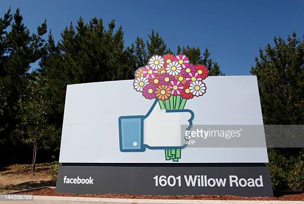 A Facebook 'like' button logo with flowers is seen at the entrance of the Facebook headquarters in Menlo Park California on May 11 2012 Facebook...