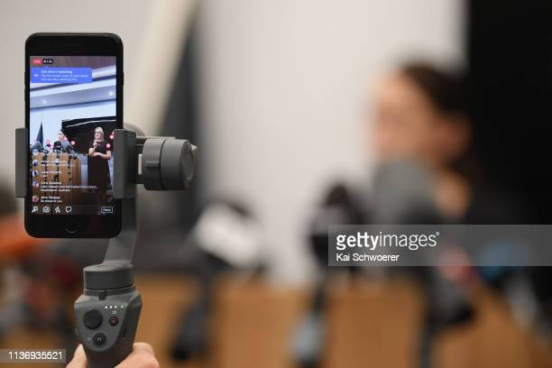 Facebook live video is seen as New Zealand Prime Minister Jacinda Ardern speaks to the media during a press conference at the Justice and Emergency...