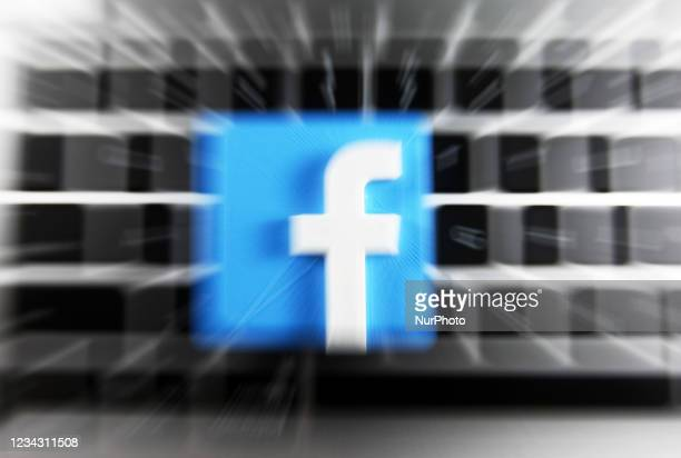 Facebook logo and a laptop are pictured in this illustrative photo in Kyiv on 29 July, 2021.