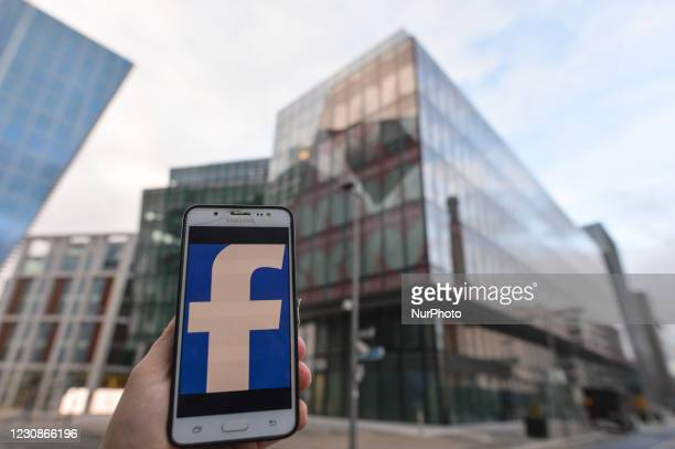 Facebook logo displayed on a mobile phone in front of Facebook EMEA headquarters on Grand Canal Square in Dublin Docklands. On Friday, 29 January in...
