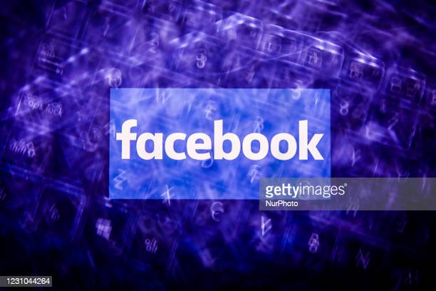 Facebook logo displayed on a phone screen and a keyboard are seen in this multiple exposure illustration photo taken in Poland on February 8, 2021....