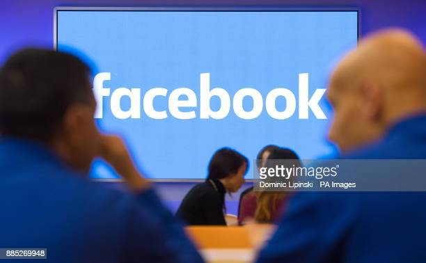 Facebook logo is displayed on a screen at Facebook's new Frank Gehry-designed headquarters at Rathbone Place in London.