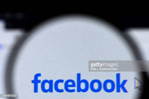 Facebook logo is pictured on a laptop screen in Moscow on August 26, 2021. - Russia has fined Facebook, Twitter and WhatsApp for failing to store the...