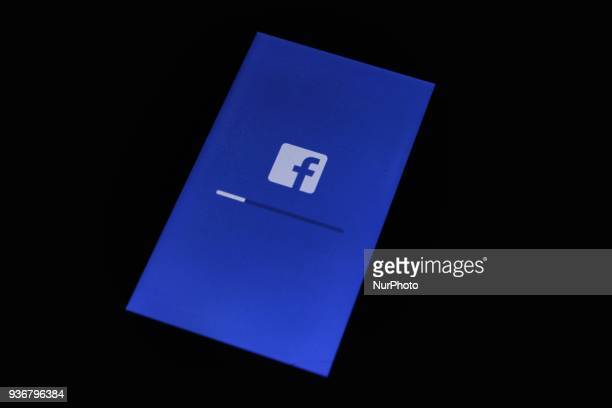 Facebook Logo is seen on a mobile phone