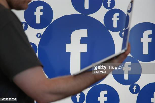 A Facebook logo is seen on various electronic devices on 28 March 2017