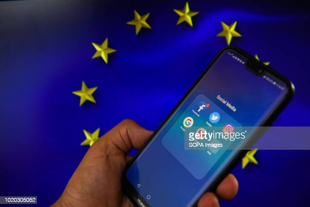 Facebook logo with European Union flag are seen in this photo illustration The European Commission is planning issue a regulation that allows to fine...