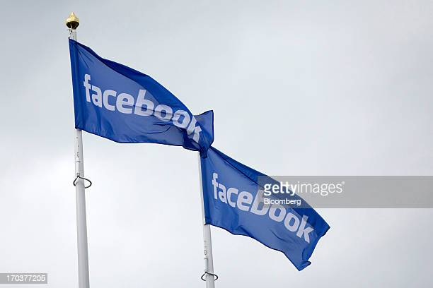 Facebook logos fly from flagpoles outside Facebook Inc's new data storage center near the Arctic Circle in Lulea Sweden on Wednesday June 12 2013 The...