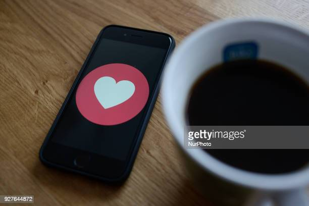 A Facebook love symbol is seen on an iphone in this photo illustration on March 5 2018