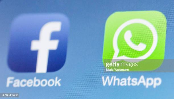 Facebook next to the WhatsApp logo on iPhone on February 25 2014 in Berlin Germany