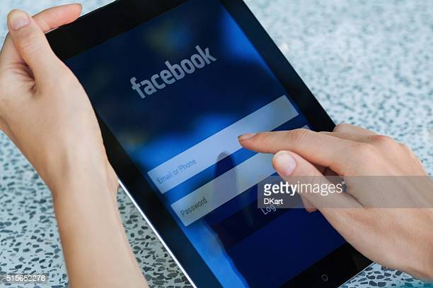 facebook on ipad - log on stock photos and pictures