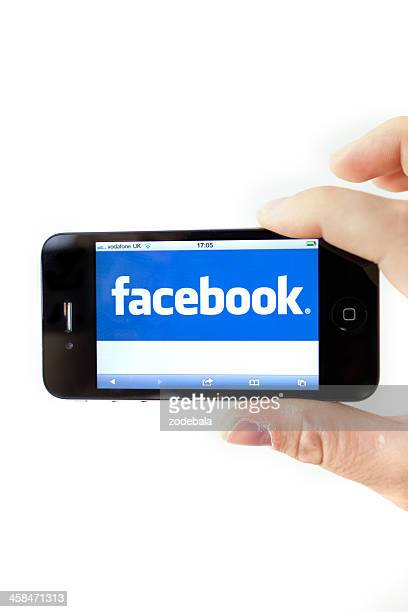 facebook on iphone 4 - community logo stock pictures, royalty-free photos & images