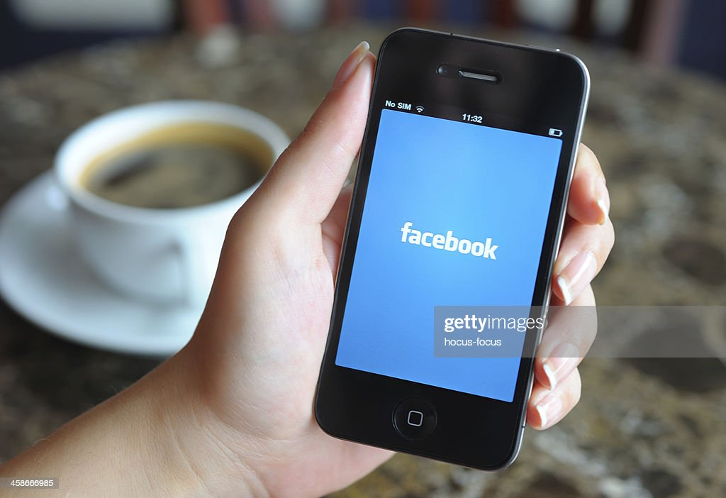 Facebook on iPhone : Stock Photo