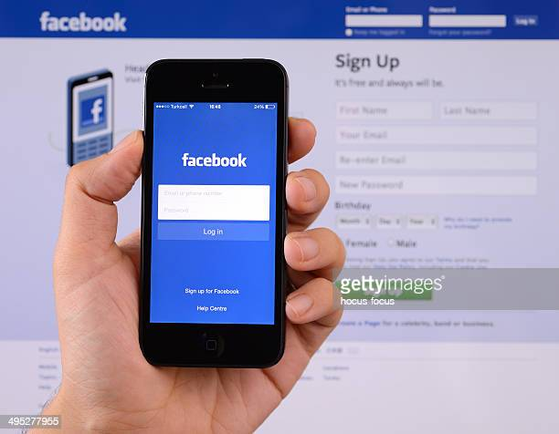 facebook on iphone smartphone - www images com stock photos and pictures