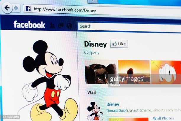 facebook page of disney on rgb laptop monitor - celebrities photos stock photos and pictures