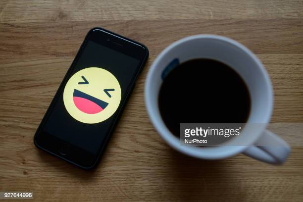 A Facebook smiley face is seen on an iphone in this photo illustration on March 5 2018