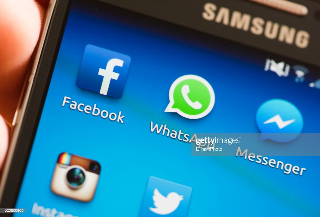 Facebook, WhatsApp and Messenger on smartphone : Stock Photo
