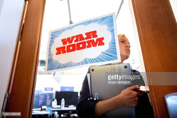 Facebook worker Erin Landers leaves the company's War Room during a media demonstration on October 17 in Menlo Park California The freshly launched...