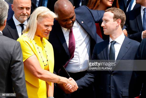 Facebook's CEO Mark Zuckerberg shakes hands with IBM's President and CEO Virginia Rometty before a family picture with guests of the Tech for Good...