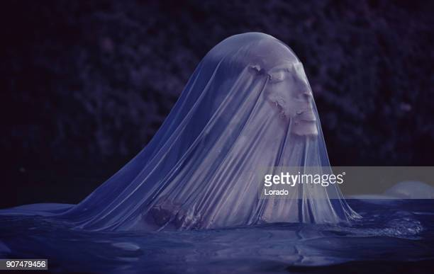 faceless merman emerging from the sea - monster fictional character stock pictures, royalty-free photos & images