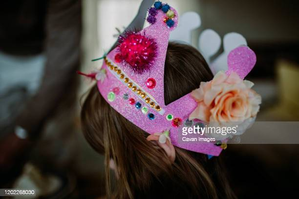 faceless portrait of young girl with homemade birthday crown - happybirthdaycrown stock pictures, royalty-free photos & images