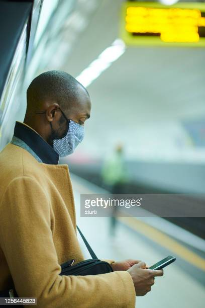 facemask subway traveller - station stock pictures, royalty-free photos & images