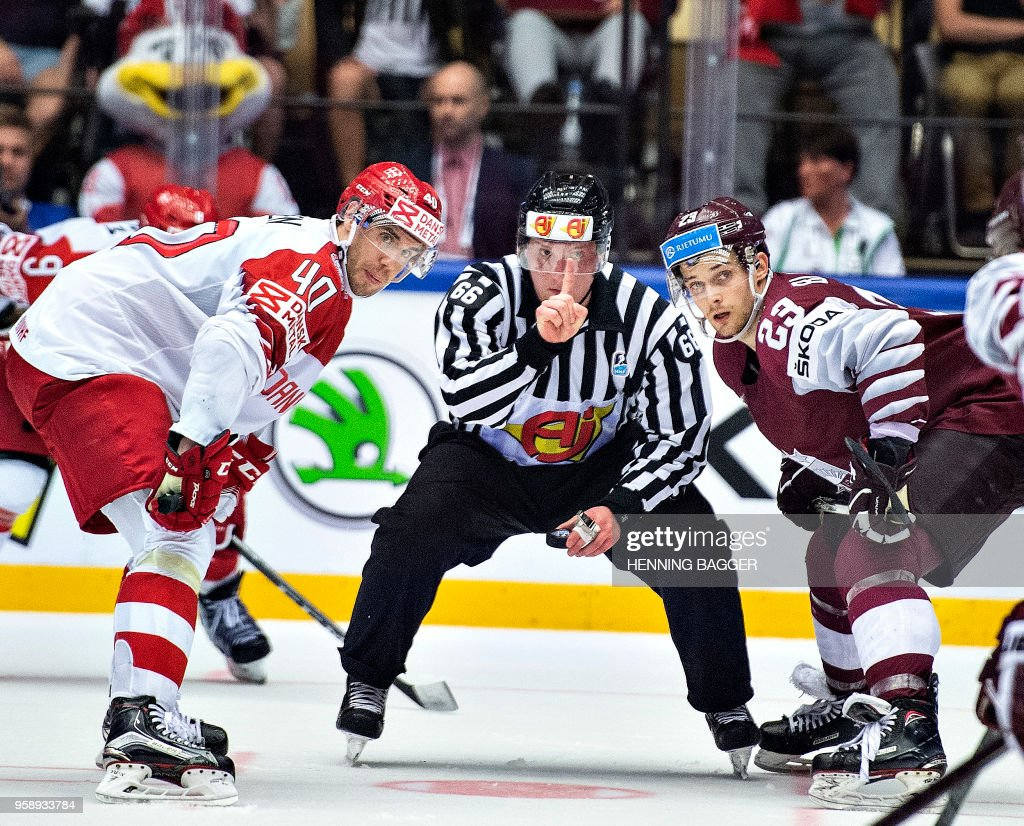 Faceoff between Jesper Jensen of Denmark and Teodor Blugers of Latvia during the IIHF World Championship Group B match between Latvia and Denmark in Jyske Bank Boxen in Herning, on May 15 , 2018. (Photo by Henning Bagger / Ritzau Scanpix / AFP) / Denmark OUT