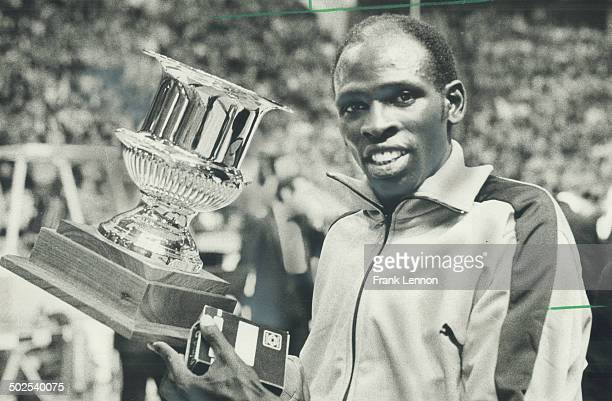 Faces another boycott Kenyan runner Mike Boit shown with his trophy after winning the 1000yard Friday night at the Toronto Star Maple Leaf Indoor...