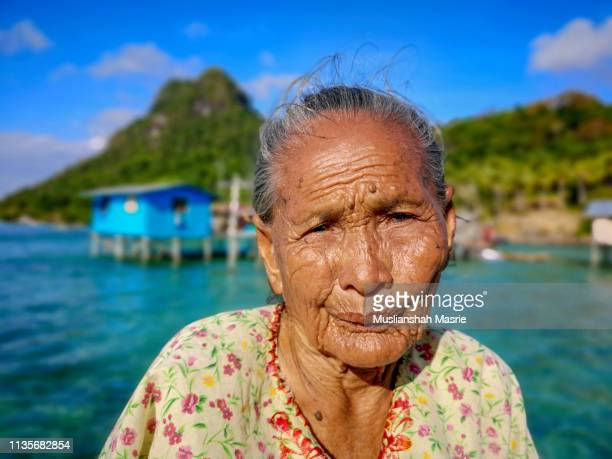 faces of sea gypsy women in the island called tatagan mabul located in semporna, sabah. malaysia. borneo. - bajau stock pictures, royalty-free photos & images