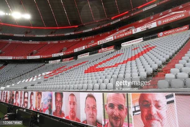 Faces of the fans are shown on advertising screens around the stadium as no fans are permitted to attend the matches during the Bundesliga match...
