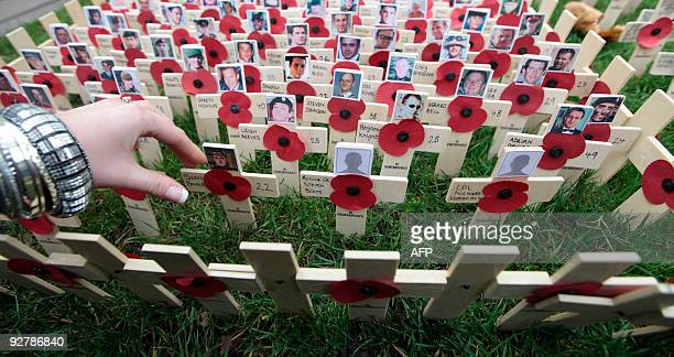 Faces on crosses are placed in the Garden of Remembrance to honour Britain's fallen servicemen and women at Westminster Abbey in London, on November...