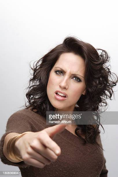 faces/woman pointing to camera somewhat angry - pointing at camera stock photos and pictures