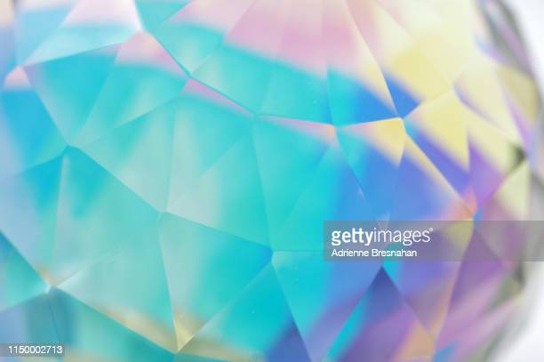 faceted crystal ball, close-up - crystal stock pictures, royalty-free photos & images