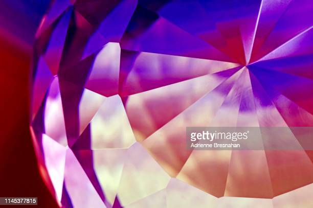 faceted crystal, close-up - diamond gemstone stock pictures, royalty-free photos & images