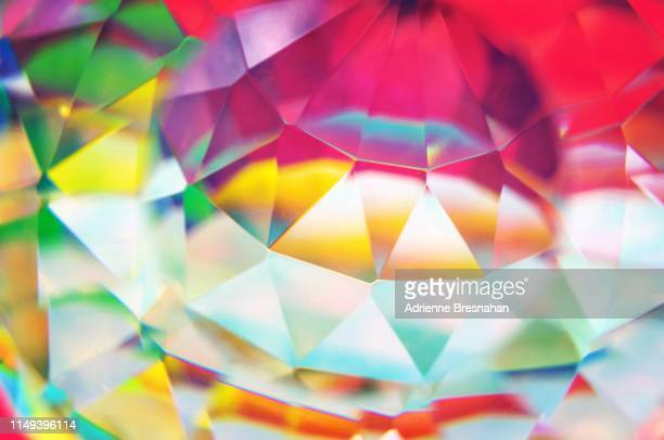 faceted crystal with distortion and light effects - crystal stock pictures, royalty-free photos & images