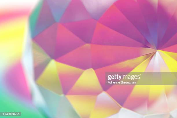 faceted crystal with pastel light effects - diamond gemstone stock pictures, royalty-free photos & images
