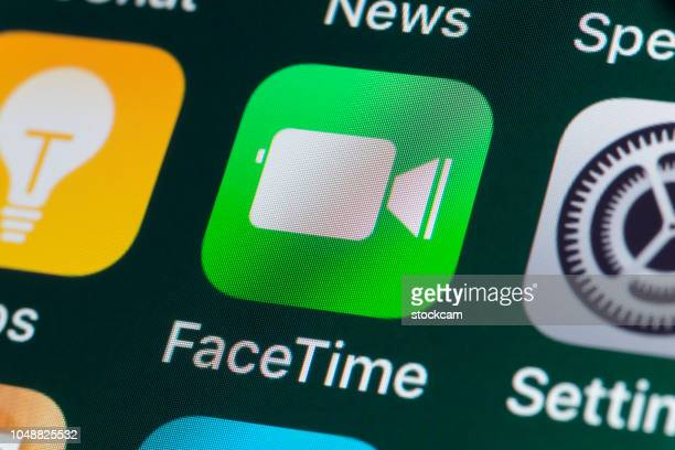 facetime, settings, tips and other apple apps on iphone screen - calendar icon stock photos and pictures