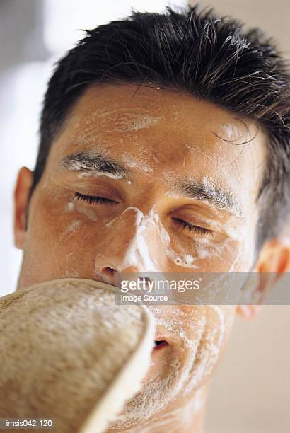 facial cleansing - loofah stock photos and pictures