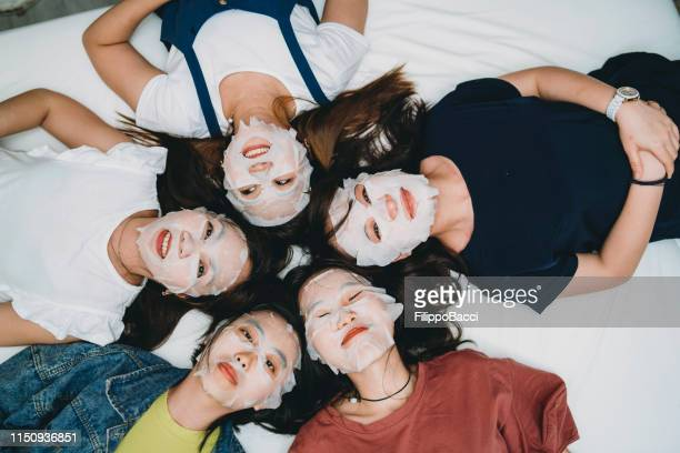 facial masks night with friends at home - cloth face mask stock pictures, royalty-free photos & images