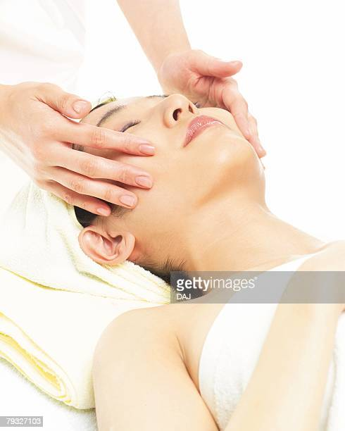 facial massage, high angle view - druckpunkt stock-fotos und bilder