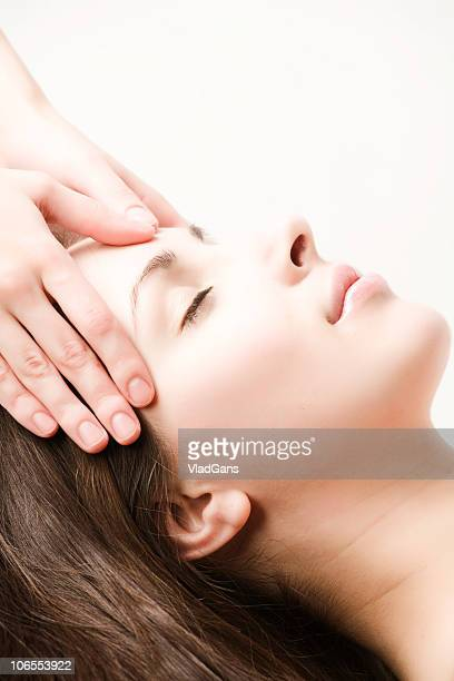 facial massage - head massage stock photos and pictures