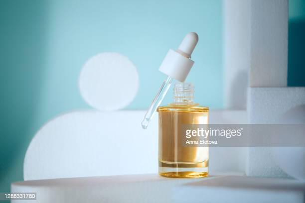 facial product in glass bottle. trendy product of the year - ingredient stock pictures, royalty-free photos & images