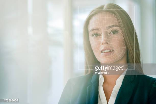 facial recognition, businesswoman with grid over her face - directrice stockfoto's en -beelden