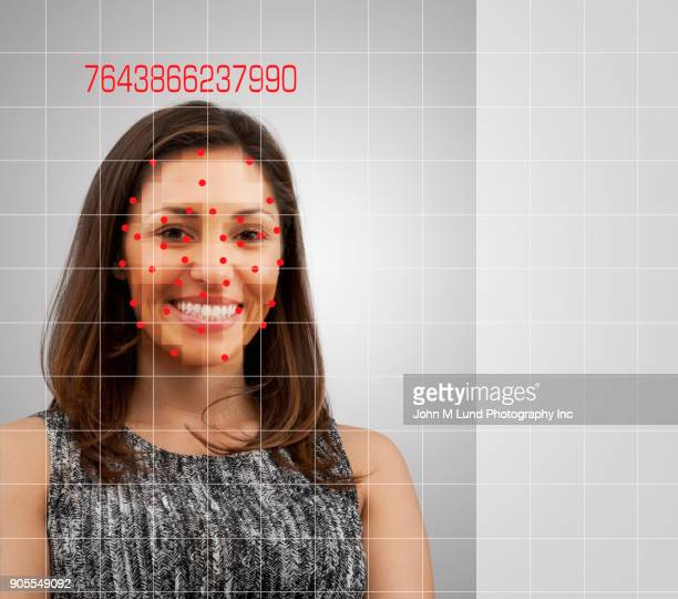 facial recognition of smiling mixed race woman - biometrics stock photos and pictures