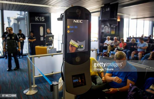 Facial recognition scanners sit ready inside Terminal 3 before an American Airlines flight to London Heathrow was scheduled to board on Wednesday...
