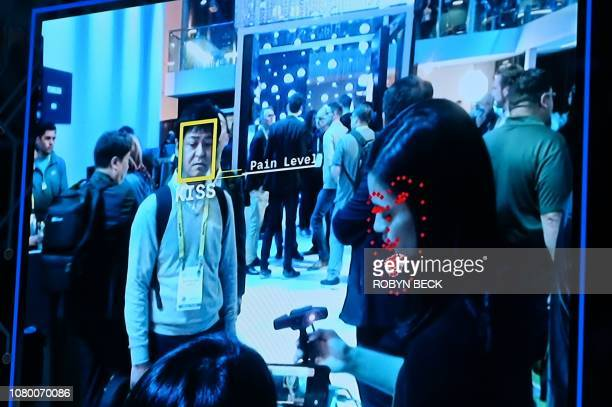 Facial recognition software is demonstrated at the Intel booth at CES 2019 consumer electronics show, January 10, 2019 at the Las Vegas Convention...