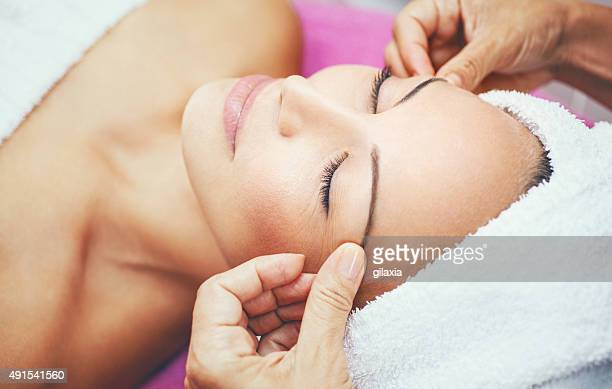 facial treatment at beauty salon. - beauty care occupation stock photos and pictures