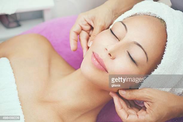 Facial treatment at beauty salon.