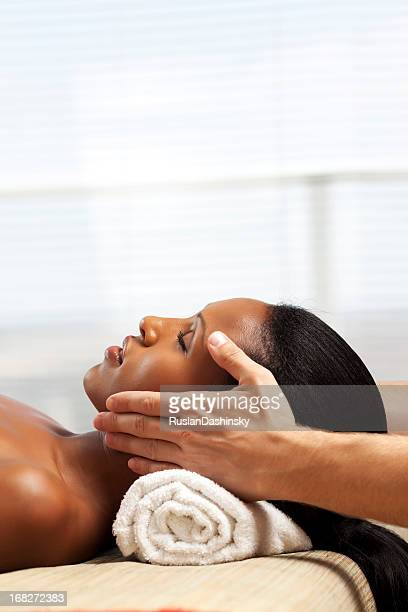 facial treatment at spa - massage black woman stock photos and pictures