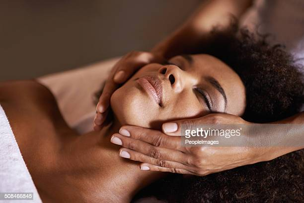 facials are so relaxing - massage black woman stock photos and pictures